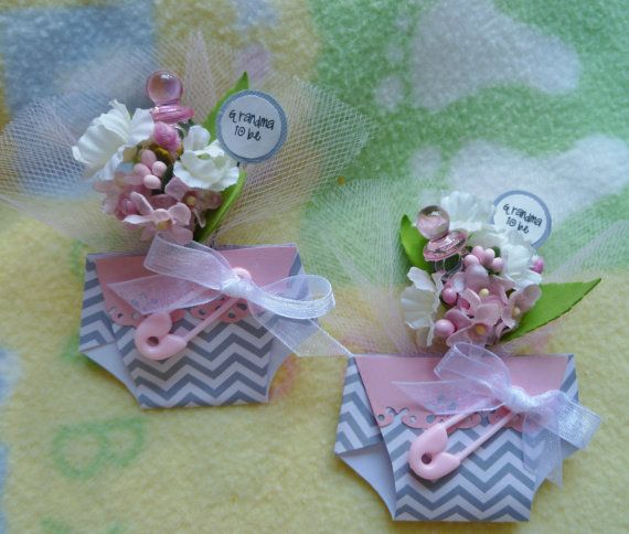 Baby shower corsage...beautiful and unique...diaper with flowers. ♥ How lovely to honor and celebrate the generations at your baby shower!! :) Zoom in on pictures for details...your corsage will be differ these are custom created.  ~~~~~~~~~~~~~~~~~~~~~~~~~~~~~~~~~~~~~~~~~~~~~~ This listing is for one corsage. ~~~~~~~~~~~~~~~~~~~~~~~~~~~~~~~~~~~~~~~~~~~~~~  Materials: 1 neatly folded card stock paper diaper artificial silk, paper, or felt flowers various embellishments, etc. Tulle…