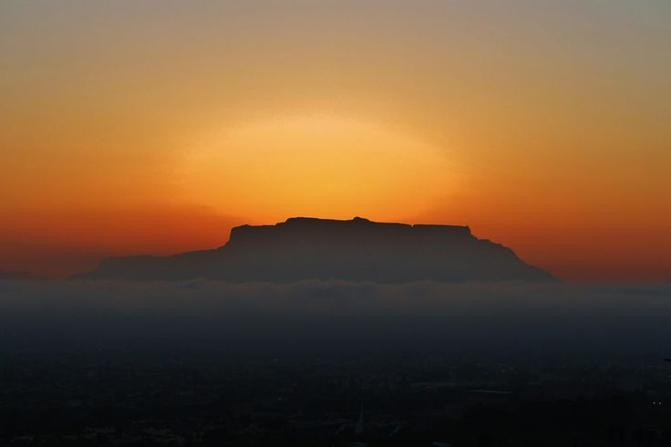 Table Mountain (Khoikhoi: Hoerikwaggo, Afrikaans: Tafelberg) is a flat-topped mountain forming a prominent landmark overlooking the city of Cape Town in South Africa, and is featured in the Flag of…