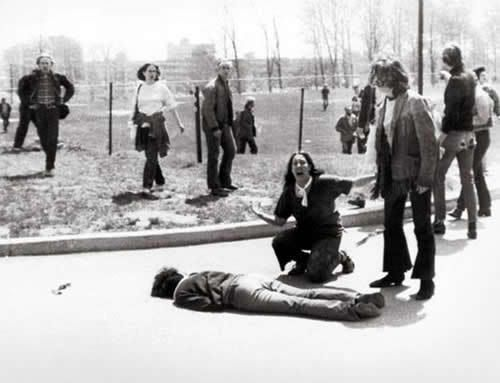 Kent State-1970...  The news that Richard Nixon was sending troops to Cambodia caused a chain of protests in the U.S. colleges. At Kent State the protest seemed more violent, some students even throwing rocks. In consequence, The Ohio National Guard was called to calm things down, but the events got out of hand and they started shooting. Some of the victims were simply walking to school. The photo shows 14-year-old Mary Ann Vecchio kneeling over the body of Jeffrey Miller who had been shot by...: Hand, School, State 1970, Student, Protest, U.S. States