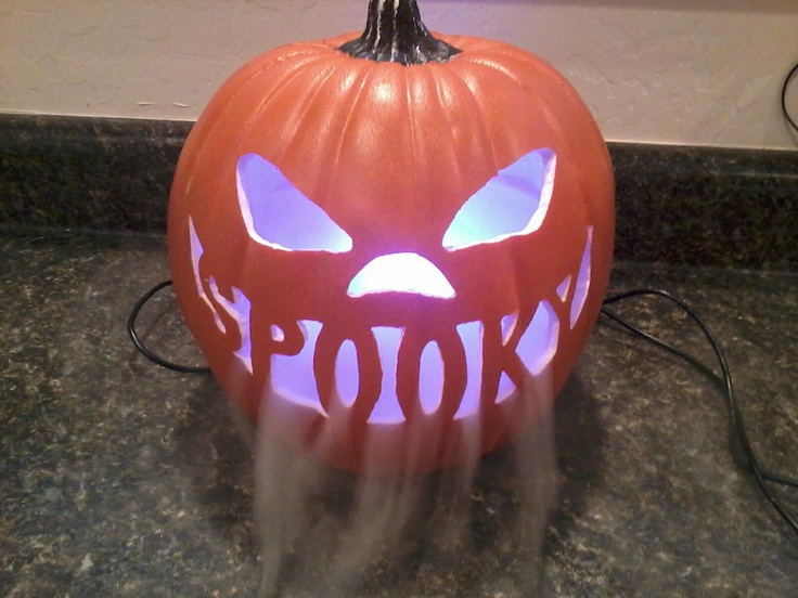 Carve a craft pumpkin with dremel leaving at least two