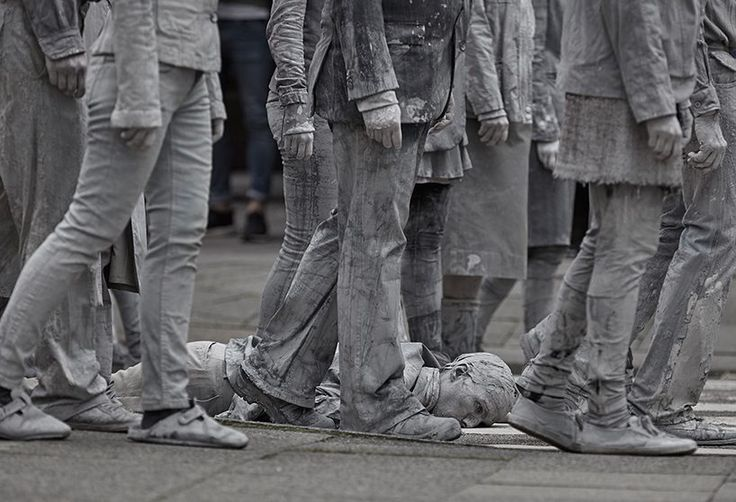 through this silent and overwhelming art performance, the silhouettes covered in clay are calling out for a grander humanity and solidarity during times of turmoil.