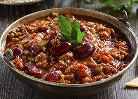 This Turkey & Veggie Chili makes a great one-pot meal. The beans provide healthy carbs, the turkey provides lean protein, and the carrots, zucchini, onion and tomatoes supply the veggies. #recipe #chili