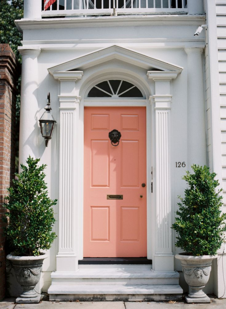White entry and peach coloured door with black door furniture #doors #peach