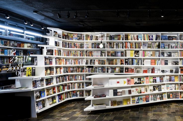 New York's East Village, St. Mark's Bookshop has been selling books to students, academics, artists and other discerning readers ever since 1977. Completed by Clouds Architecture Office. The brief called for a flexible space. As a result, the architects wrapped the interior of the store with a continuous, slightly concave bookshelf that literally embraces the space. In the middle, the shelf bulges outwards, concealing a small office for the staff within.