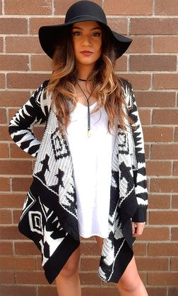 Aztec Cardi by SAN JOSE features a stunning waterfall neckline. The womens cardigan has full length sleeves and an asymetric hemline. Available in black and white aztec print.