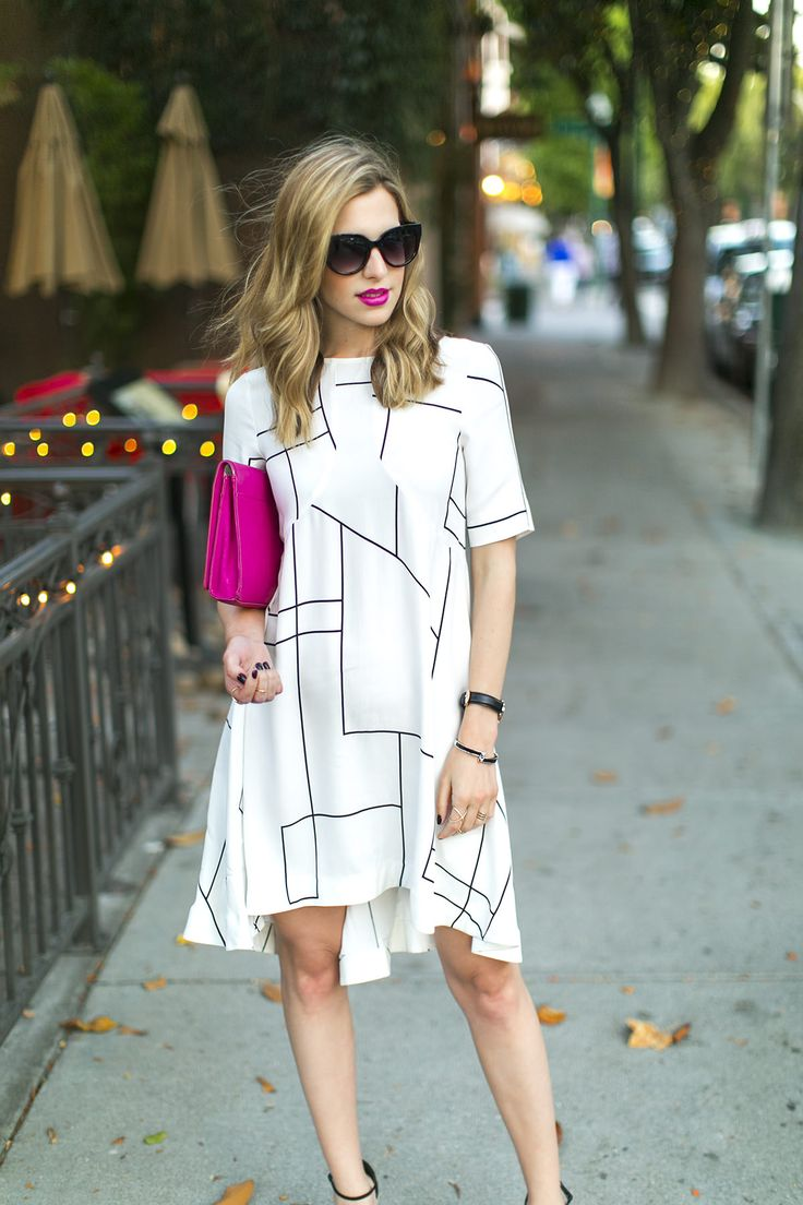 Geometric print summer dresses look great with bold pop of color accessories.