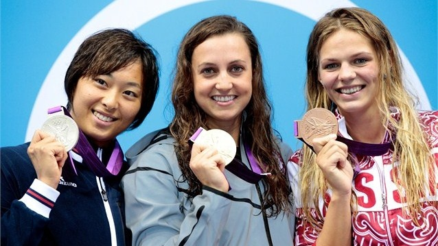 Silver medallist Satomi Suzuki of Japan, gold medallist Rebecca Soni of the United States and bronze medallist Iuliia Efimova of Russia pose on the podium during the medal ceremony for the women's 200m Breaststroke Final on Day 6 of the London 2012 Olympic Games.