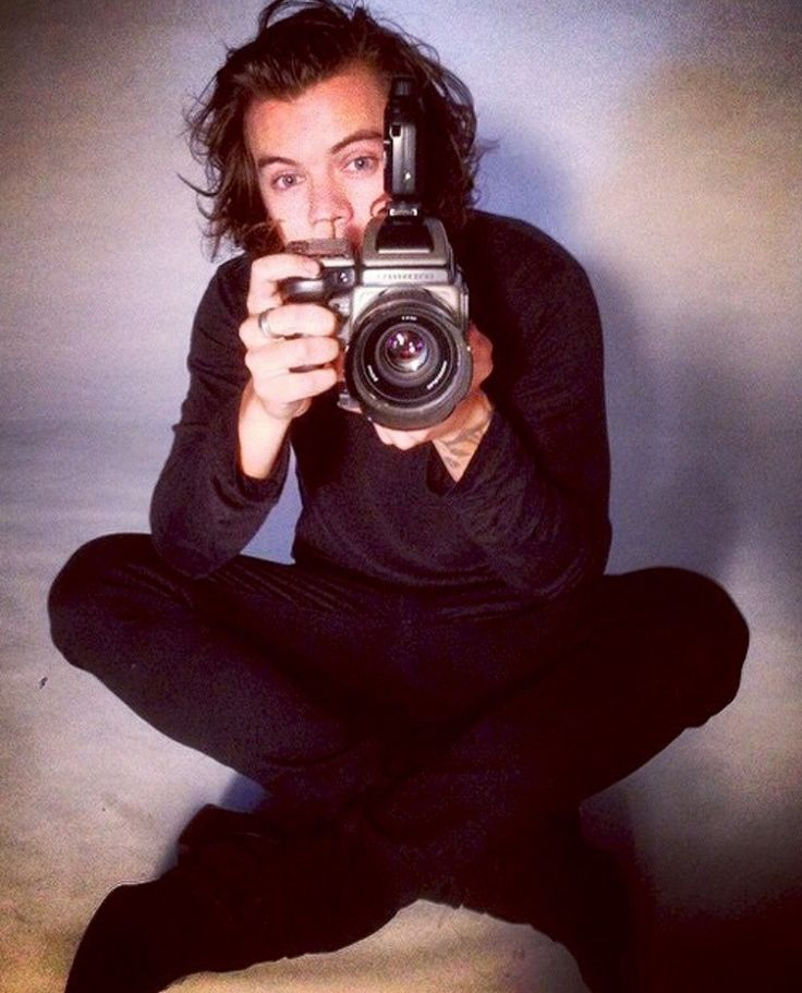 Imagine Harry's trying to take a picture of your daughter Y: Look at Harry:)