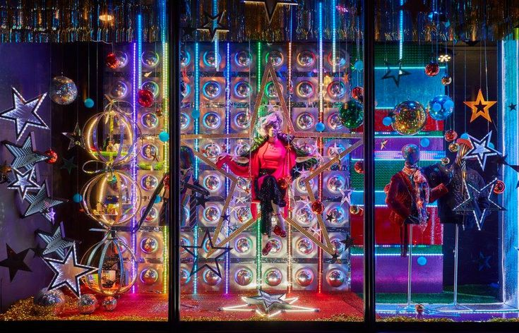 Stars bubbles and neon colours in Harvey Nichols Christmas 2017 window display