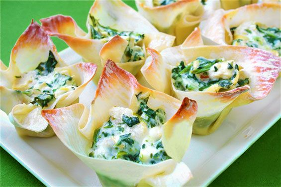 24 wonton wrappers (available in the refrigerated produce section!)  5 oz. (half of a 10 oz. box) frozen, chopped spinach — thawed and drained  1 (14 oz.) can artichoke hearts, drained and chopped  1/2 cup sour cream  4 oz. (half a block) cream cheese, room temperature  2 cloves garlic, minced  1/4 cup parmesan, grated  1/2 cup mozzarella or Italian blend cheese, grated  dash of freshly ground black pepper