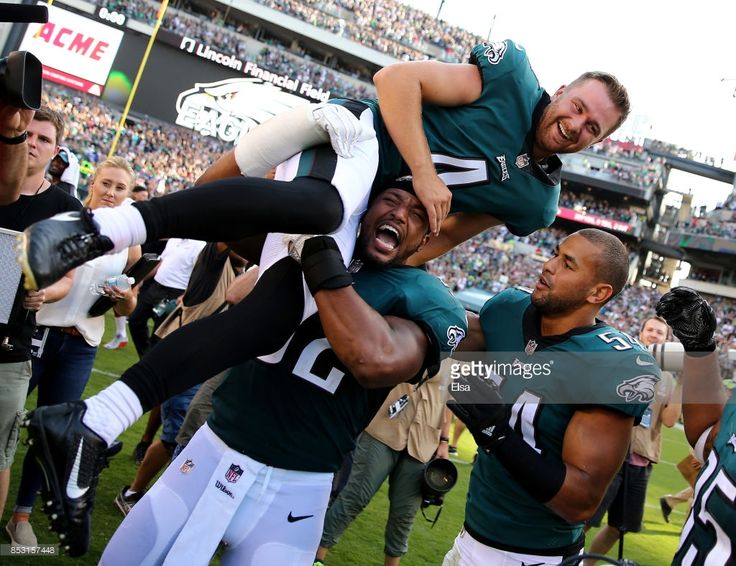 Jake Elliott #4 of the Philadelphia Eagles is picked up by teammates Najee Goode #52 and Kamu Grugier-Hill #54 after Elliott kicked the game winning field goal with 1 second left in the game against the New York Giants on September 24, 2017 at Lincoln Financial Field in Philadelphia, Pennsylvania.Elliott kicked the 61 yard field goal to defeat the New York Giants 27-24.