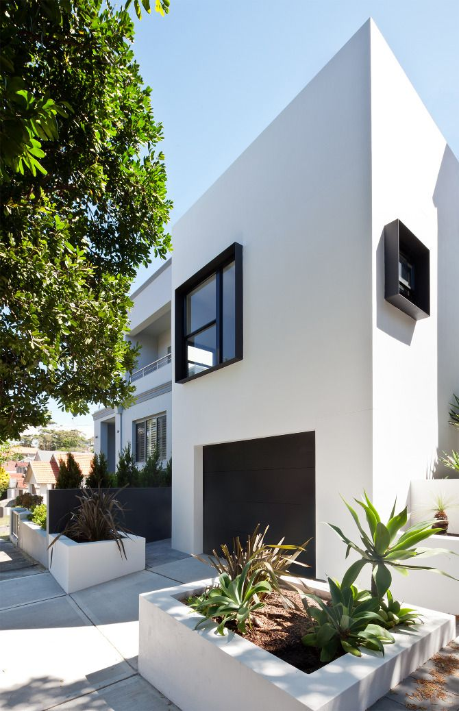 White house + black windows. (House Clarkeby Tribe Studio Architects)