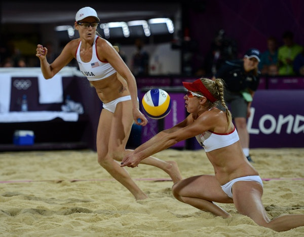 USA's Jennifer Kessy, right, plays the ball in front of teammate April Ross