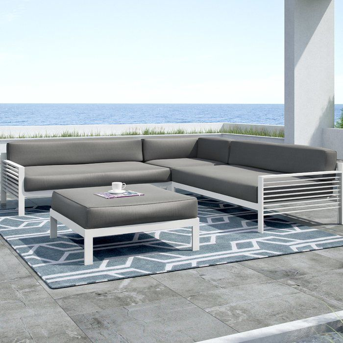 Add a touch of sleek style to your patio or veranda ensemble with this eye-catching seating group, featuring clean-lined aluminum frames and white finish.