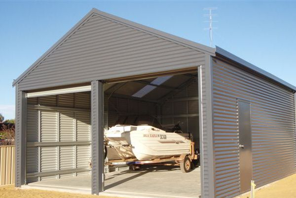 Horizontally clad double garage with a 25 degree pitched roof.