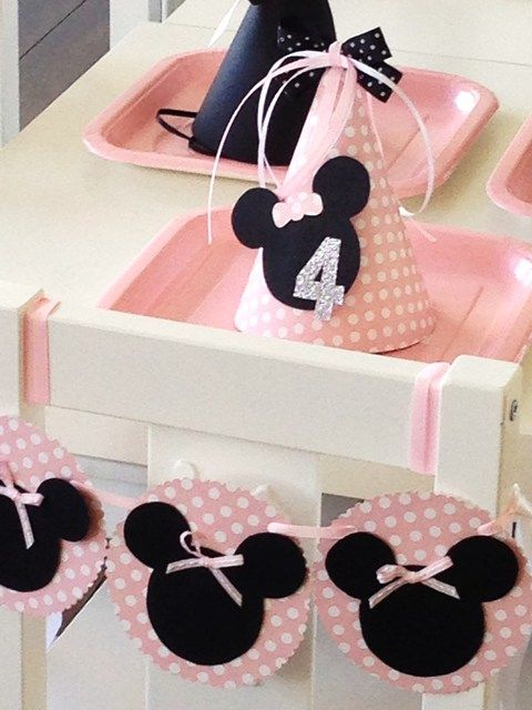 Pretty party hats from a Minnie Mouse Birthday Party! See more party ideas at CatchMyParty.com!