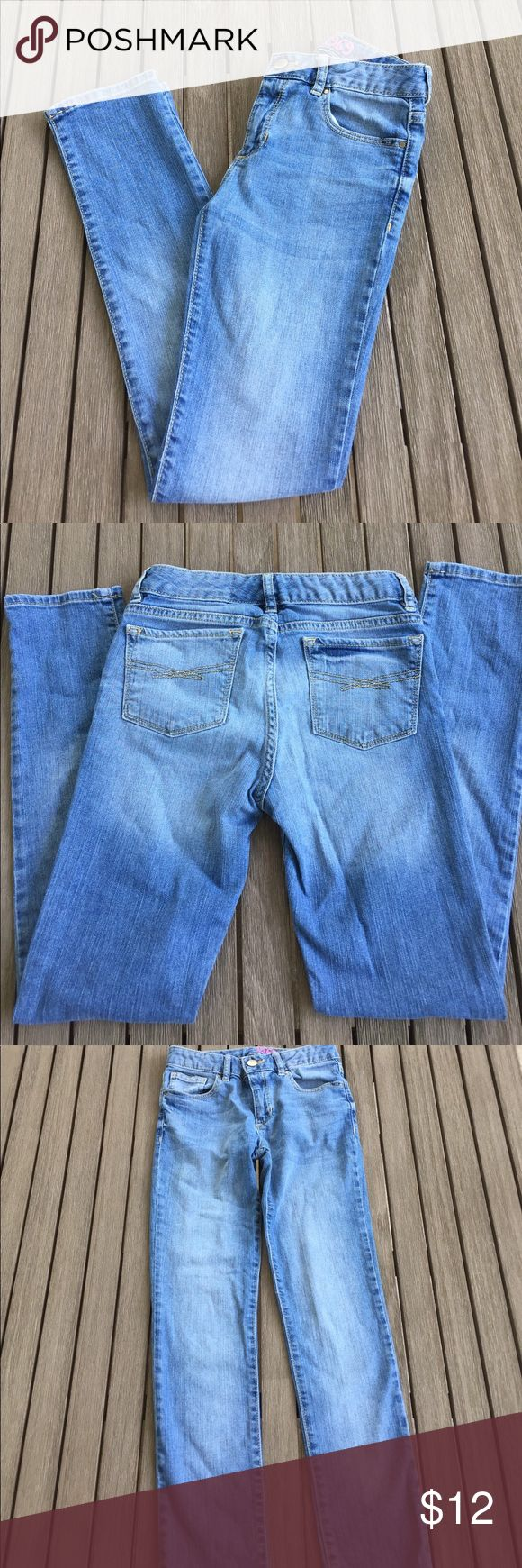 Gapkids Super Skinny Jeans Size 12 Regular Girls Gap Super Skinny Jeans. Good used condition with barely noticeable spots on both knees (see 2 pics). Interior tab adjustable waistband. Great light blue color with no holes or distressing! 99 cotton/ 1 Elastane. GAP Bottoms Jeans