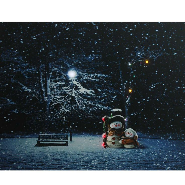 """19.5"""" Snowmen in a Park Battery Operated LED Lighted Canvas Wall Art"""