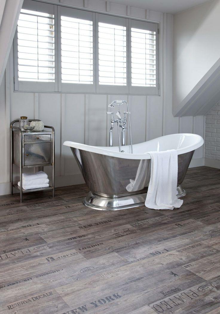 A rustic bathroom with a modern twist! #vinyl #flooring #crates #writing #rustic #interior #design #bath #bathtime