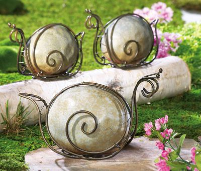 These look like fun to make!   Stone & Metal Snail Garden Sculpture Lawn Ornaments -- These would be fairly easy to make.