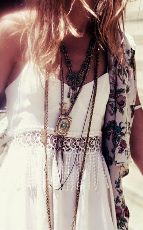 White maxi spray tan and lots of necklaces great summer look