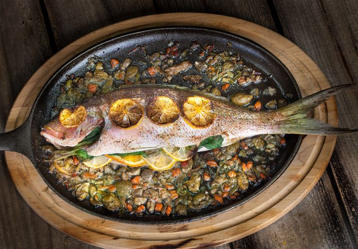With herbal French sorrel and sliced lemon, this stuffed and baked Yellowtail Snapper is a perfect example of how delicious whole fish can be.