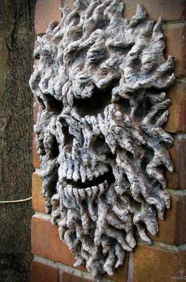 Make this out of expanding foam, build up to desire size and carve out eyes, teeth and nose with a knife. Paint. Weather proof too. CREEPY!!