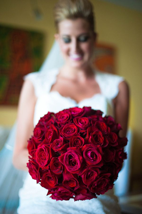 Amazingly full red rose bridal bouquet / Photo by Lyndah Wells Photography