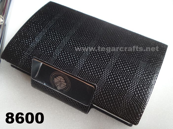 8600: A Business Card Holder for an exclusive souvenir ordered by Kementerian Desa, Pembangunan Daerah Tertinggal, dan Transmigrasi Republik Indonesia. Rough texture similar to leather snake with separate opener of the lid. The right choice to serve as a banks souvenir or government agencies. Ideal also to serve as the exclusive merchandise or to be given to customer when you visited them.
