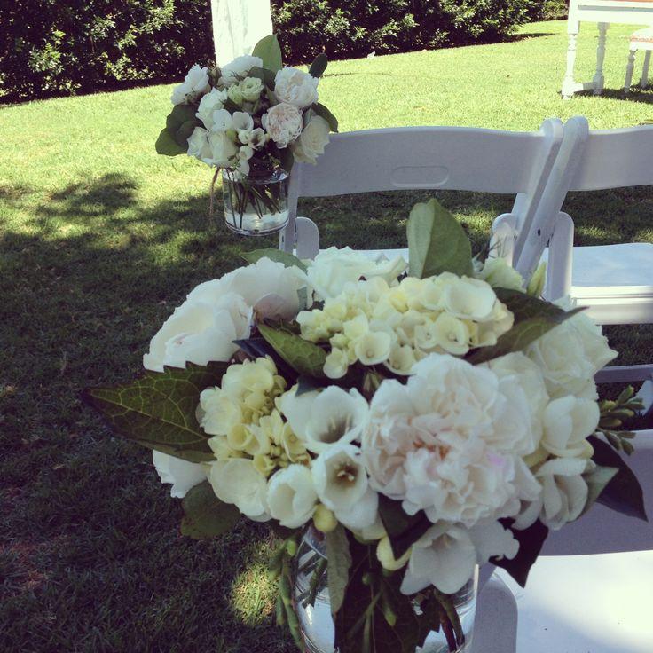 www.beautiflora.com  pew ends for Figtree Byron Bay wedding by beautiflora