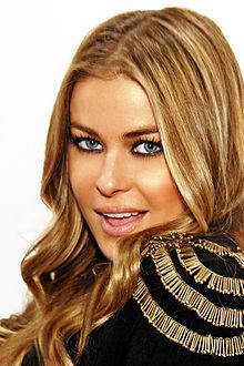 Carmen Electra (Tara Leigh Patrick) - April 20, 1972  model, actress, television personality, singer, & dancer. She gained fame for her appearances in Playboy magazine, on the MTV game show Singled Out, Baywatch & dancing with the Pussycat Dolls. started her professional career in 1990 as a dancer at Kings Island amusement park in Mason, Ohio. Electra has been married to basketball star Dennis Rodman & Dave Navarro, lead guitarist for the rock band Jane's Addiction. Born in Sharonville, OH