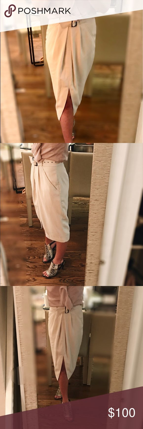 💫flash sale💫  Reiss | front slit fitted skirt Superior-quality materials, tailored to perfection: a must-have summer wardrobe staple.!  This Off-white midi skirt is adorned with a front slit and matching, removable belt: fun, sexy, versatile piece will never lose its shape.  fully lined yet lightweight, the fabric/dress can be worn across all seasons.  Excellent condition -- bought at end of last season,  but is a bit to big for me this year.  Hate to part with it!! Reiss Skirts Midi