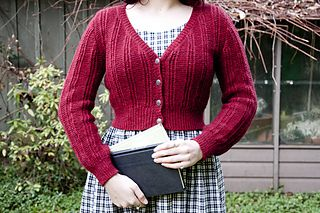 This cozy cardigan is the perfect way to add some vintage charm to any outfit. Mary Mead features a delightful combination of columns of garter stitch and eyelets and is knit from the top down, seamlessly. The upper back is knit first, and the upper fronts are picked up from the cast-on edge. The fronts and back are joined when stitches for the underarms are added. Waist shaping is hidden in the panels of garter stitch, making the sweater quite fitted without losing any of the eyelet…