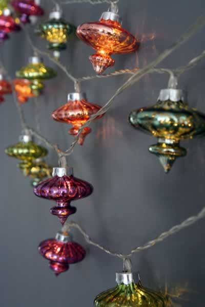 beautiful Kasbah LED light chain to decorate your house.  The line of glass Morrocan inspired decorations hand on a 3m line of lights.  The full length including extra wire to the plug is 5.85m and comes with a transformer.