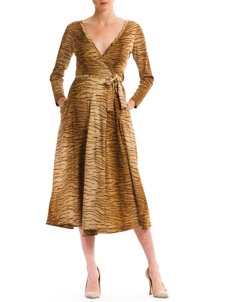 """- Product Description - Measurements DETAILS In the 70s, Diane von Furstenberg took the fashion world by surprise with her little jersey wrap dresses. """"Feel like a woman. Wear a dress"""" was her unassum"""