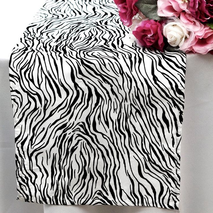 Abstract Table Runner - Black / White | Knowing you, you've got a lot of big ideas and spectacles planned, so we've brought you some very wild and unique tiger overlays that not just make your tabletops stunning, but also sets the mood for excitement. Appropriately named Vegas for Las Vegas, the center of entertainment in the world, this linen is only meant for someone who wants to create excitement in LARGE quantities, Las Vegas style.