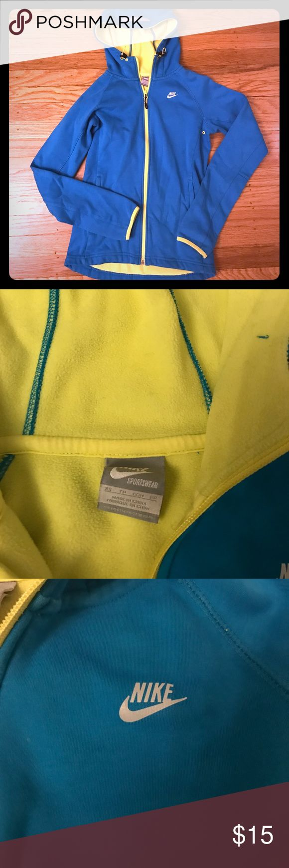 NIKE zip up hoodie fleece lined - Size XS Extra warm, form fitting, bright turquoise jacket with fleece yellow lining. Reflective hood with bungee draw strings. Has a faint stain on left side (picture taken). Nike Jackets & Coats Utility Jackets