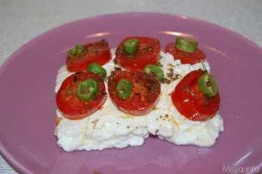 Feta al cartoccio con pomodorini e olive