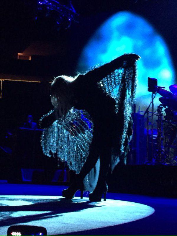 Stevie onstage  ~ ☆♥❤♥☆ ~   bowing to the audience at the end of a song she performed, spreading her gossamer-thin shawl wide ~ it resembles butterfly wings ~ beautiful