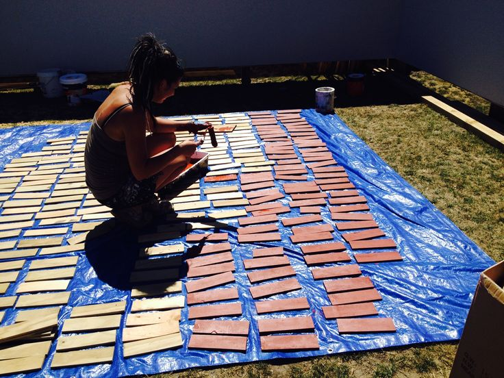 Painting the many fake wooden bricks.  These were used to make the brick walls that went around our garden which was based on a WW2 british garden