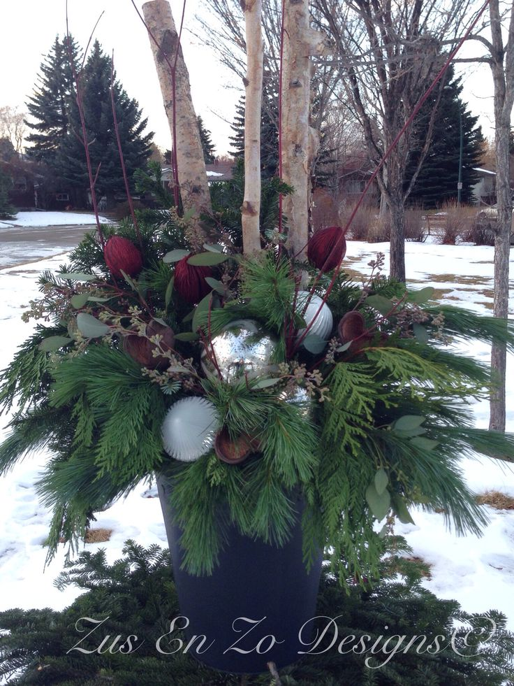 Fresh greenery, shiny balls - very inviting...Christmas planter