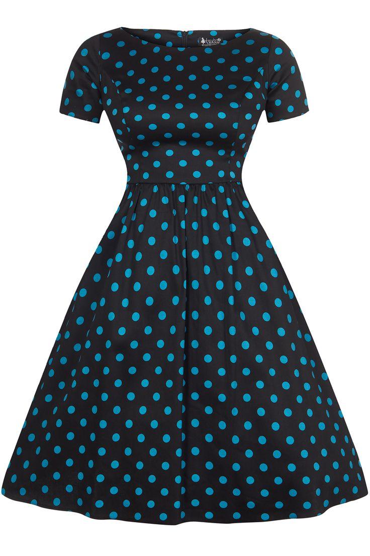 Šaty Lady V London Eloise Black and Teal Polka Retro šaty ve stylu 50. let. Nádherné šaty vhodné na oslavy, večírky, do tanečních kurzů i do práce. Krásné tyrkysové puntíky na černém podkladu. Příjemný pružný materiál (97% bavlna, 3% elastan), slušivý, pohodlný střih s lodičkovým výstřihem, krátký rukáv, rozšířená sukně s řasením v pase, zapínání na zip v zadní části.
