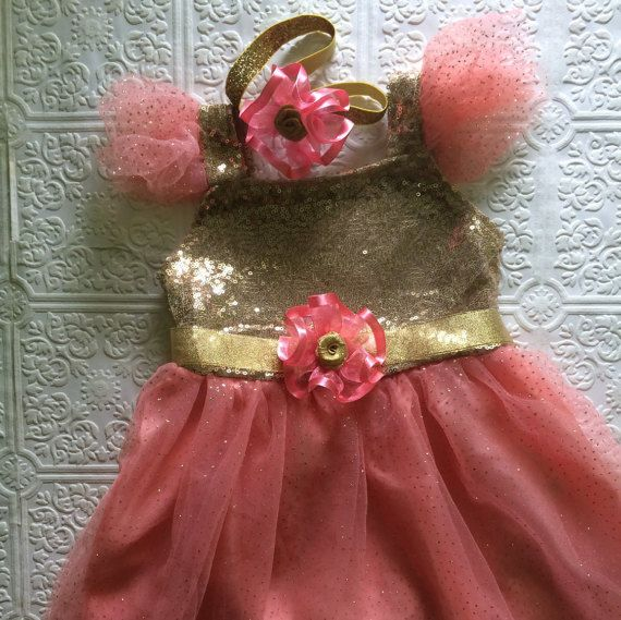 Pink and gold birthday dress set with a sash and headband.