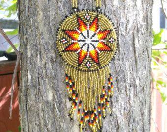 collana stella del mattino  circa 3 3/4 diametro.  la collana può essere regolata da 48 e fino a 12  pelle indietro con DC impresso su di esso.