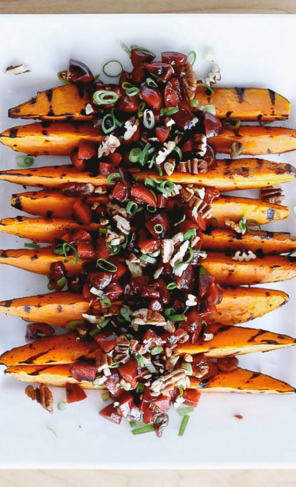 These grilled sweet potato wedges are topped with a fresh and colorful cherry salsa. Serve them as a vegetarian and gluten free side dish at your next BBQ or on top of quinoa as a healthy weeknight dinner.
