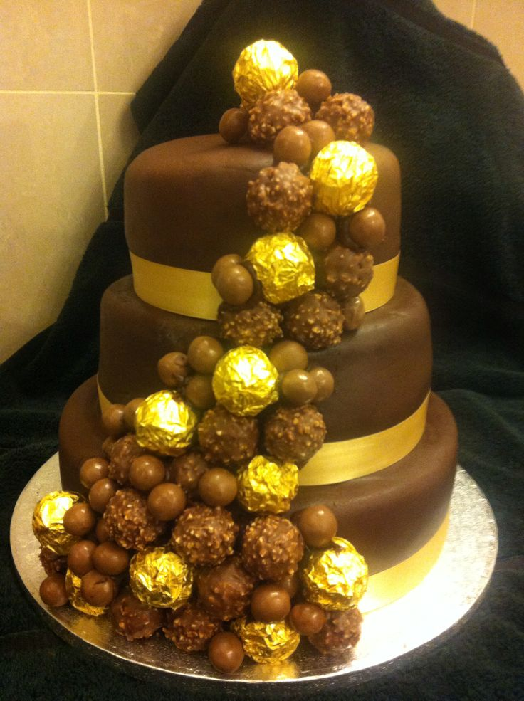 Ferrero Rocher Chocolate Wedding Cake. Three tiers of chocolate fudge cake covering in chocolate icing with a Ferrero rocher and malteaser cascade. £350