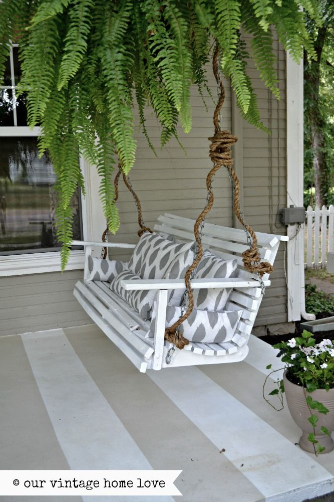 our vintage home love. porch swing.  love the rope tied around the chain.