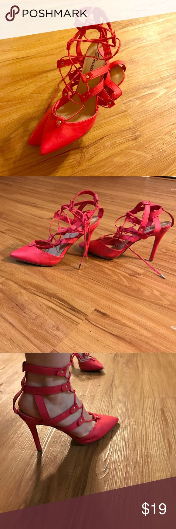 High hill shoes. Pink in color, mint condition. They're super comfortable! Feels like you're wearing flip flops. Very good for women with bad back and who aren't comfortable in walking in very high hill shoes. Shoes Heels