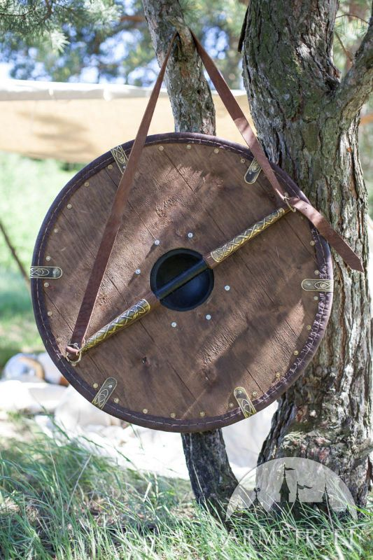 Perfectly crafted handmade heavy Viking's shield. Shield is decorated with brass accents and stainless steel shield-boss