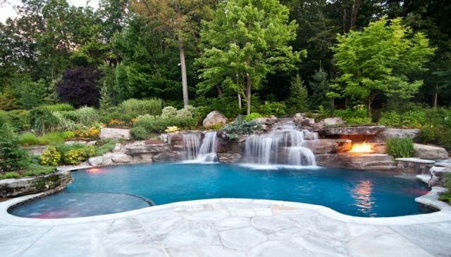 The New Jersey pool renovation company utilized 200 tons of boulders, a diverse landscape, waterfalls, and a Volcanic Fire Pit to establish the natural setting and complete the luxury pool renovation. Description from prweb.com. I searched for this on bing.com/images